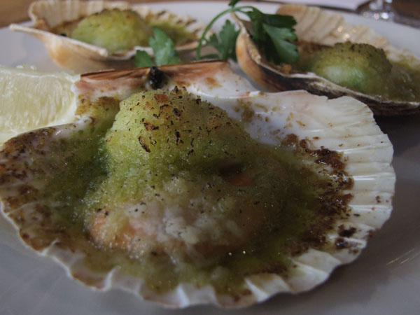 South Coast scallops with garlic butter and breadcrumbs with a glass of Albariño, at FishWorks, London
